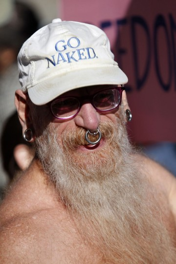 Woody Miller, of San Francisco, wears a hat that says 'Go naked,' during a rally against banning nudity in parts of the city in San Francisco, California, November 14, 2012. (Beck Diefenbach/Reuters)