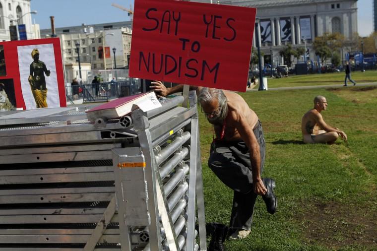 A man undresses at Civic Center Plaza in San Francisco, California October 30, 2012. (Robert Galbraith/Reuters)