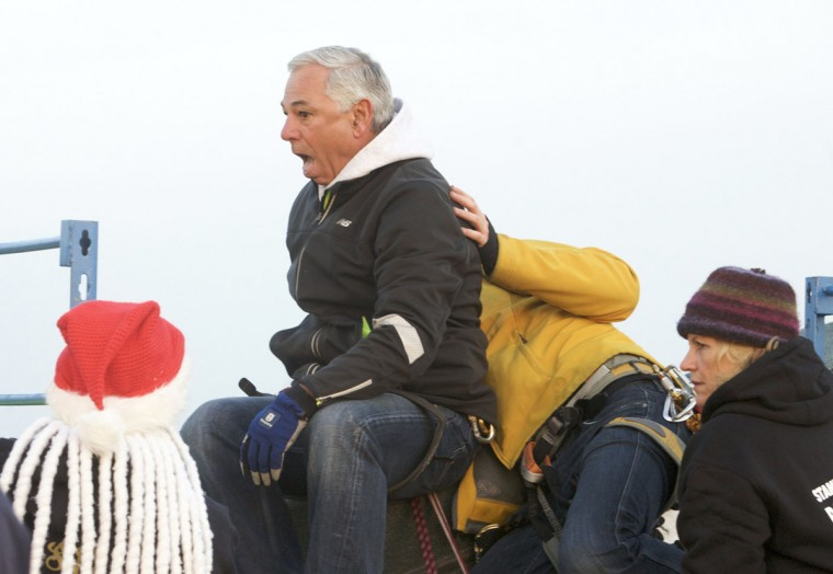 Bobby Valentine, former Boston Red Sox manager, reacts before rappelling 22 stories from one of the tallest buildings in Stamford to mark the start of Santa's arrival as part of the Christmas event 'Heights & Lights' in Connecticut. (Michelle McLoughlin/Reuters)