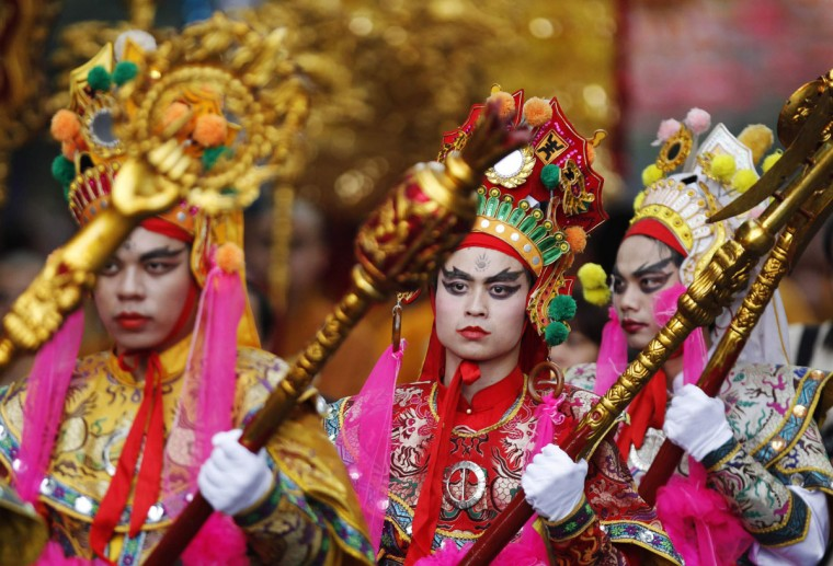 Buddhist believers dressed as the Yaksas, known as the 12 heavenly generals in Buddhist mythology, march before the opening ceremony of the seventh congress of Vietnam's Buddhist Sangha Association in Hanoi. (Kham/Reuters)