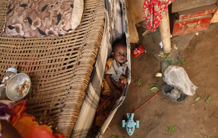 A boy lies in a baby hammock in his family's hut in a slum area of the Akhdam community in Yemen's western port city of Houdieda. Yemeni Akhdam, or servants, are similar to hereditary castes, but are distinguished by their African features and the menial jobs they perform. Widespread prejudice places the Akhdam at the bottom of Yemen's social ladder. Picture taken October 14, 2012. (Khaled Abdullah/Reuters)