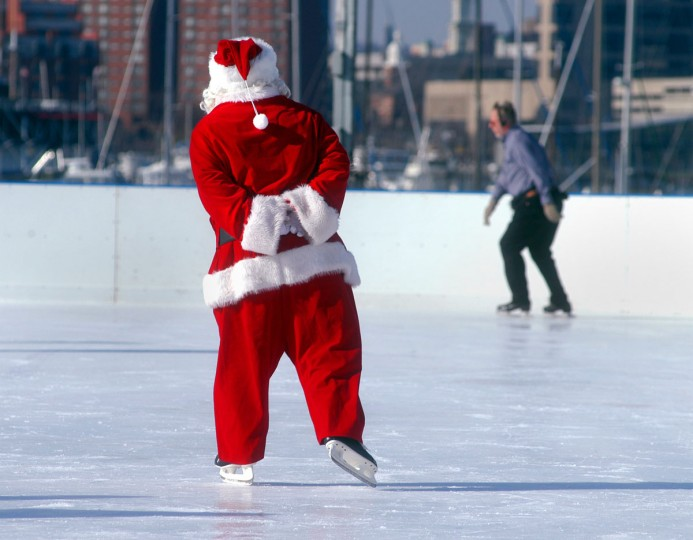 Santa (Domonic Salamone), who normally work at the Salvation Army but hired temprary as santa here since he can skate, was one of the attractions of the opening of the new ice rink over at Harbor Point on December 20, 2003. (Chiaki Kawajiri/Baltimore Sun)