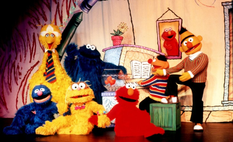 "Sesame Street characters pose during a production of Sesame Street Live's ""Everyone Makes Music,"" which premiered in 2001. (Handout photo)"