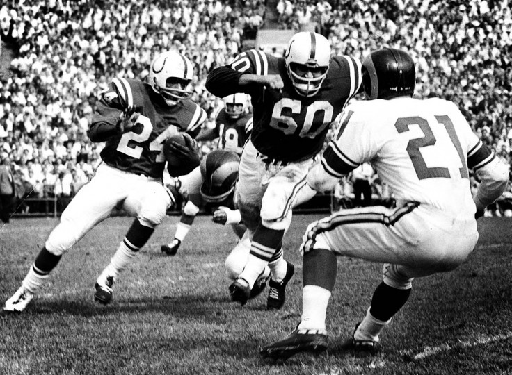 In October of 1960 at a Colts game George Preasis, #60, blocks Ed Meador, Ram defensive halfback, right, to help the Colts' Lenny Moore, #24, around right end in the scoreless first period. (Robert F. Kniesche/Baltimore Sun)