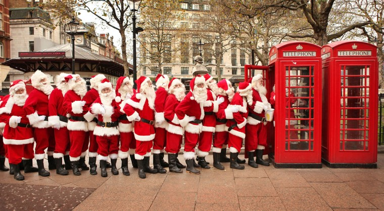 Santa performers line up at a phone box in Leicester Square on November 13, 2008 in London. Santa performers attended the Odeon Cinema in Leicester Square to watch a new film entitled 'Santa School: The Film.' (Peter Macdiarmid/Getty Images)