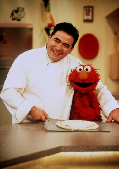 "Emeril Lagasse and Sesame Street character Elmo cook up some tasty treats on ""Elmo's Magic Cookbook,"" a program that ran on the Food Network in 2001. (Richard Tremine/Handout photo)"