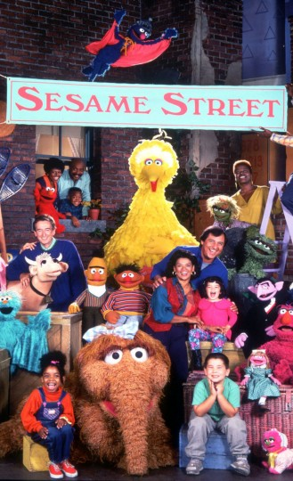 The Muppets and actors of Sesame Street pose for a photo on the set prior to the beginning of their 25th season. (Handout photo)
