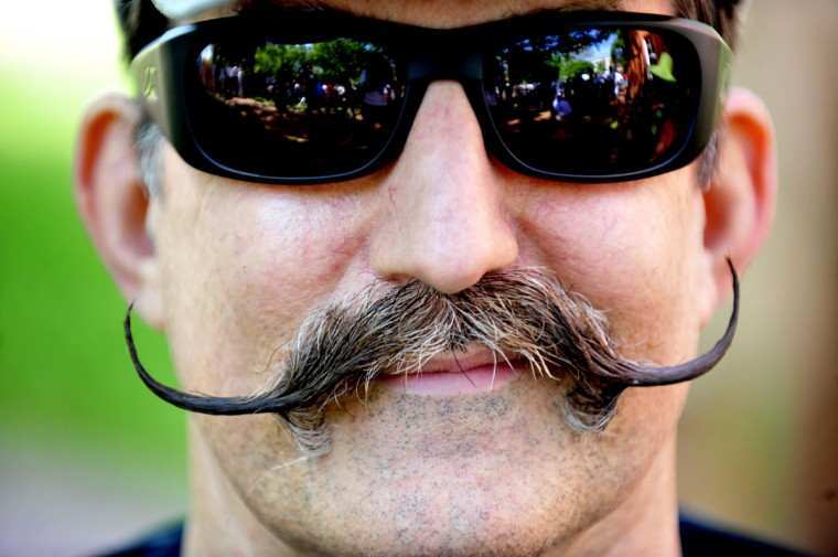 Johnny Tatum sported his usual up-turned mustache as he enjoyed the annual croquet match between St. John's and the Naval Academy on April 20, 2011. (Monica Lopossay/Baltimore Sun)