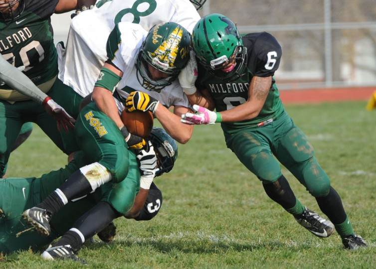 North Harford's Scott Angstadt goes head to head with a Milford Mill defender in Saturday's game. (Nicole Munchel/Baltimore Sun Media Group)