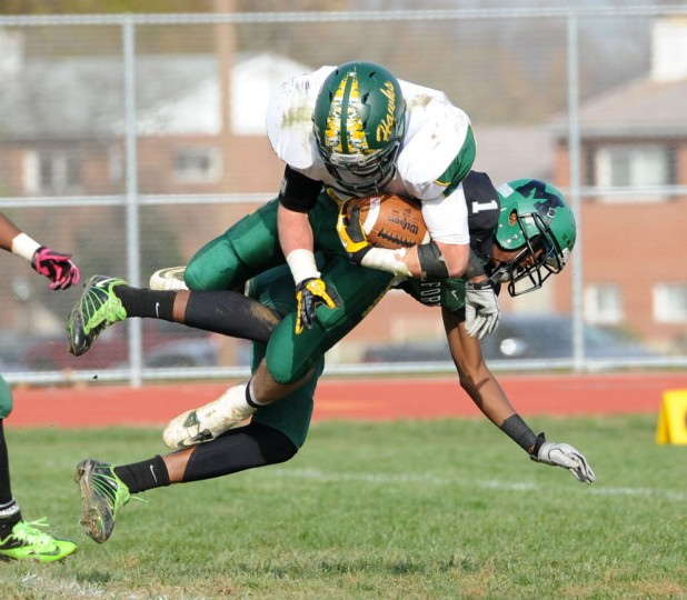 North Harford's Tyler Campbell flies through the air after getting tangled with a Milford Mill defender. (Nicole Munchel/Baltimore Sun Media Group)