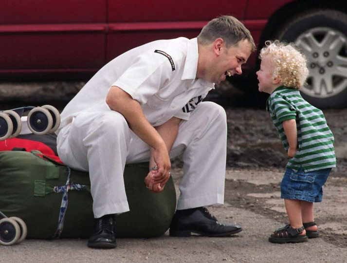 Petty Officer Josh Cackowski of Duluth, Minn., shares a moment with his 18-month-old son Jacob after the USNS Comfort returned to Baltimore from the Arabian Gulf during the Iraq war in 2003. (Jed Kirschbaum/Baltimore Sun)