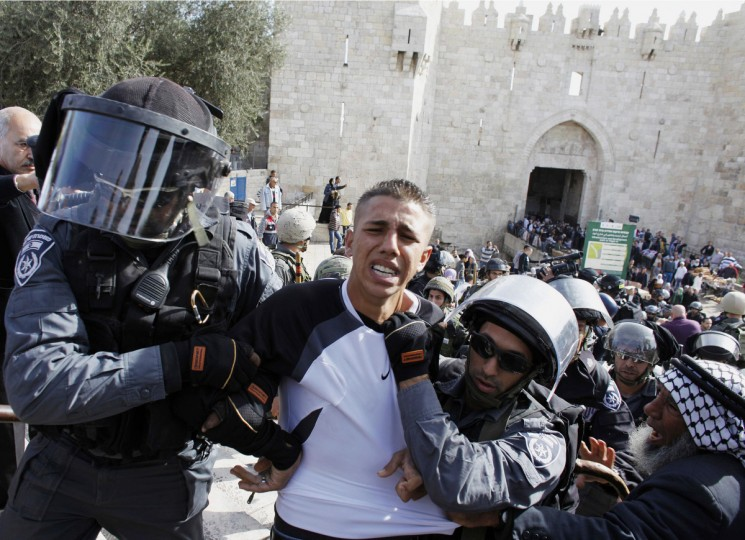 Israeli border police officers detain a Palestinian demonstrator during clashes after a protest against Israel's military operation in Gaza, outside Damascus Gate in Jerusalem's Old City. The latest upsurge in a long-running conflict was triggered on November 14 when Israel killed Hamas's military mastermind, Ahmed Al-Jaabari, in a precision air strike on his car. Israel then began shelling the enclave from land, air and sea. (Ammar Awad/Reuters)