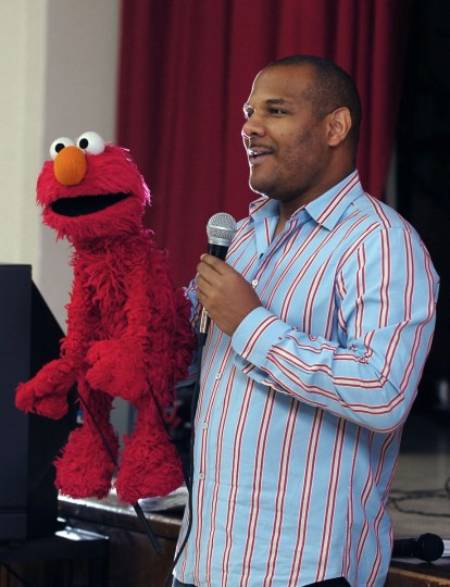 Kevin Clash, who grew up in Turner's Station in Baltimore County, is the puppeteer behind Sesame Street's Elmo. Clash and Elmo visited students at Brehms Lane Elementary School in Baltimore in 2007 to encourage students to follow their dreams in career choices. (Kenneth K. Lam/Baltimore Sun Photo)