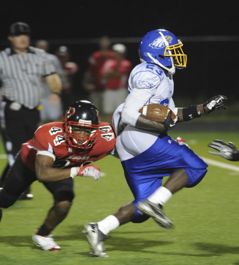 Aberdeen's Dante Warfield gains 22 yards while his pants were falling down in a Friday night game against Edgewood. (Nicole Munchel/Baltimore Sun Media Group)