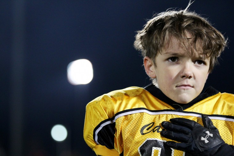Winfield's Brandon Faya stands for the National Anthem before the youth football league 6-8 championship game against Catonsville at Blandair Park in Columbia on Friday, Nov. 16, 2012. (Jen Rynda/Baltimore Sun Media Group)