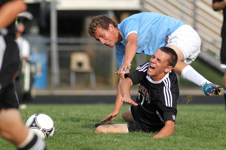 River Hill's Zach Riso, top, and Archbishop Curley's Nick York, bottom, collide going for the ball during the boys varsity soccer game at River Hill High School in Clarksville on Tuesday, Sept. 4, 2012. (Jen Rynda/Baltimore Sun Media Group)