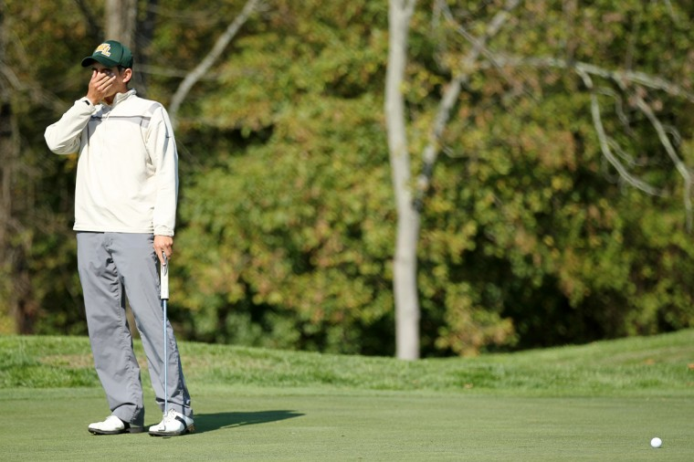 Wilde Lake's Tyler Silberberg reacts after he misses a putt on the seventh hole during the 2012 MPSSAA District V Golf Championship at Fairways Hills Golf Course in Columbia on Friday, Oct. 12, 2012. (Jen Rynda/Baltimore Sun Media Group)