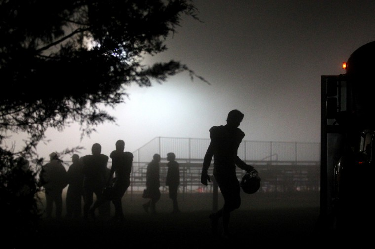 St. Paul's School football players walk back to the bus after the football game against Pallotti gets postponed due to weather at Fairland Regional Park in Laurel on Friday, Oct. 19, 2012. (Jen Rynda/Baltimore Sun Media Group)
