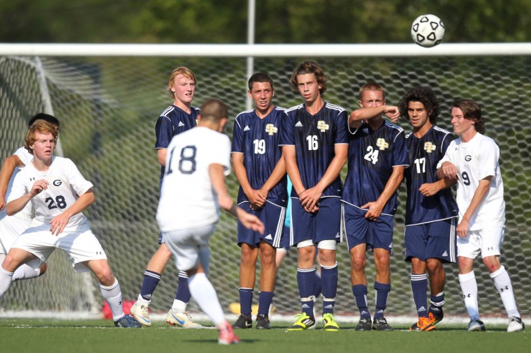 Gilman School's Sam Wancowicz, center, takes a direct kick during the first half of the boys soccer game against St. Paul's School at Gilman School in Baltimore on Wednesday, Aug. 29, 2012. (Jen Rynda/Baltimore Sun Media Group)