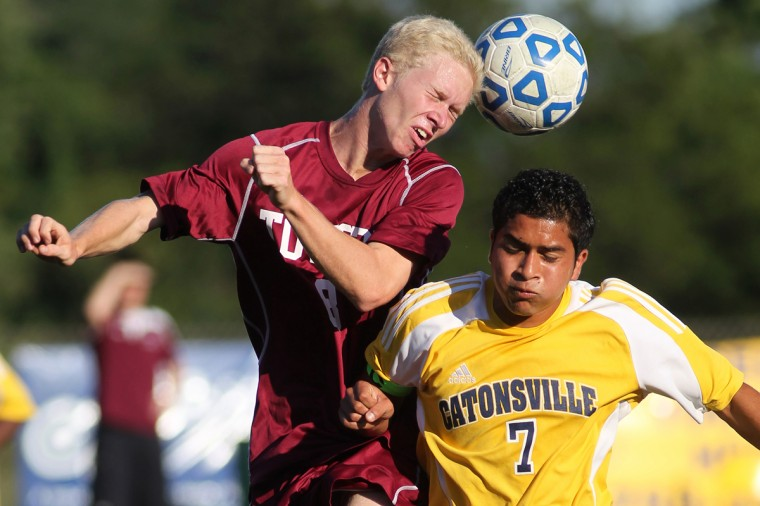 Towson's Garrett Gischel, left, and Jose Moran, right, go up for a header during the soccer game at Catonsville High School in Catonsville on Wednesday, Sept. 12, 2012. (Jen Rynda/Baltimore Sun Media Group)