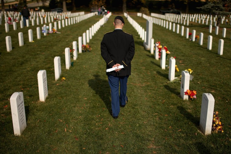 "The day after Veterans Day, U.S. Army Staff Sgt. Luke Parrott walks through the rows of headstones in Section 60 where several of his friends and soldiers he served with are buried at Arlington National Cemetery November 12, 2012 in Arlington, Virginia. A veteran of the wars in Afghanistan and Iraq, Parrott was injured in an IED blast in Baghdad in 2005. Parrott spent time sitting and talking to the graves of the soldiers he knew. ""It's as close as we can get to talking anymore,"" he said. (Chip Somodevilla/Getty Images)"
