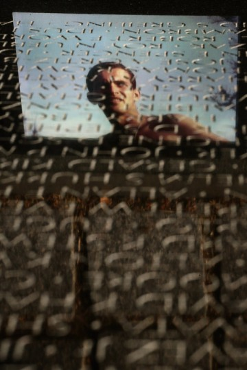 A photograph of a member of the U.S. military is reflected in the marble face of the Vietnam Veterans Memorial on the day after Veterans Day, November 12, 2012 in Arlington, Virginia. (Chip Somodevilla/Getty Images)