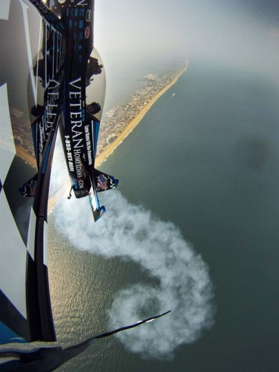 Rob Holland of Nashua, N.H., pilots his Veteran Home Loans MX2 stunt plane 3,000 feet above Ocean City in June 2011 in preparation for the annual OC Air Show. (Karl Merton Ferron/Baltimore Sun)
