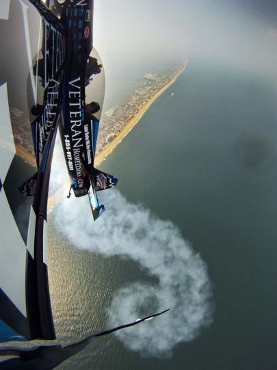 Rob Holland of Nashua, N.H., pilots his Veteran Home Loans MX2 stunt plane 3,000 feet above Ocean City in June 2011 in preparation for the annual OC Air Show. (Karl Merton Ferron/Baltimore Sun)