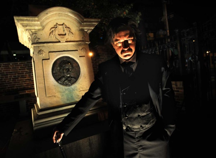 Mark Sanders as Edgar Allan Poe speaks to Halloween revelers at the Westminster Burying Ground in Baltimore, where the poet and mystery writer is spending eternity. (Algerina Perna/Baltimore Sun)