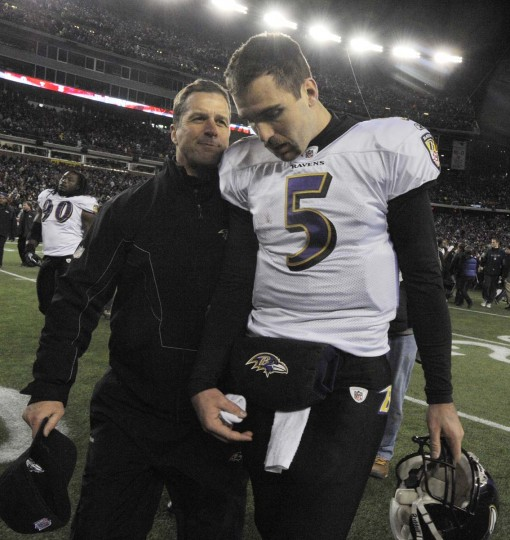 "Coach John Harbaugh walks off the field with quarterback Joe Flacco after a dropped touchdown pass and missed ""€œchip-shot""€ field goal brought a sudden end to the Ravens€™ 2011-12 season in the AFC championship against the New England Patriots. (Lloyd Fox/Baltimore Sun)"