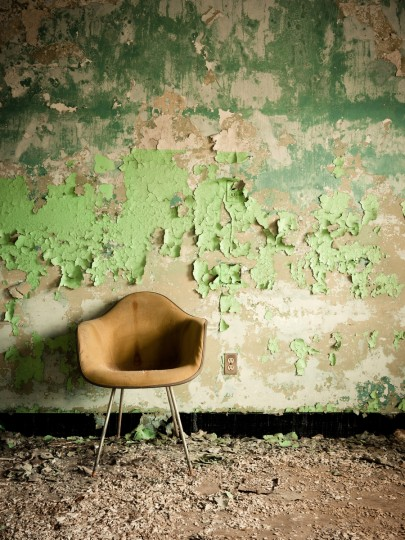 "Jake Johnson is the winner for this week's series ""Abandoned"" for his picture of a waiting room at an abandon hospital which closed in 1991. Johnson took the picture with a Panasonic GF1. Here is a critique from director of photography Robert Hamilton. ""This was a very strong category with lots of great images. I chose this one because I like the pastel colors combined with the textures of the wall. The photographer did a nice job of composition by offsetting the chair rather than photographing it straight on. This makes the image asymmetrical and adds an additional dynamic."""