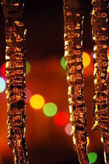 "The winner for this week's Reader SunShots series ""It Must be Art"" goes to Patricia Knight for a picture shot of icicles hanging from the gutter of her home with Christmas lights in the background. The photographer shot the picture with a Nikon D100. Here is a critique by Baltimore Sun director of photography Robert K. Hamilton: ""I like how the photographer was able to take something as ordinary as icicles and make them something special. By using a shallow depth of focus the photographer takes full advantage of the colorful lights, but stills allows the icicles to be the star of the picture."""