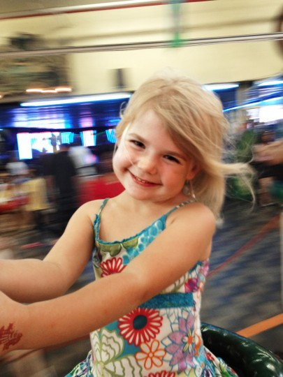 "The winner for this week's Reader SunShots series ""Cellphone Pictures"" is Dawn Folck for her picture of her little girl Kali, 5, riding the carousel in Ocean City, MD. The picture was take on an Apple iPhone 4s. Here is a critique by director of photography Robert Hamilton. ""I selected this picture because the photographer did a great job of capturing the wonderful expression of the little girl. In addition by taking the picture as the carousel was moving the background is blurred giving the picture a sense of motion and making what would have been a distraction a plus."""