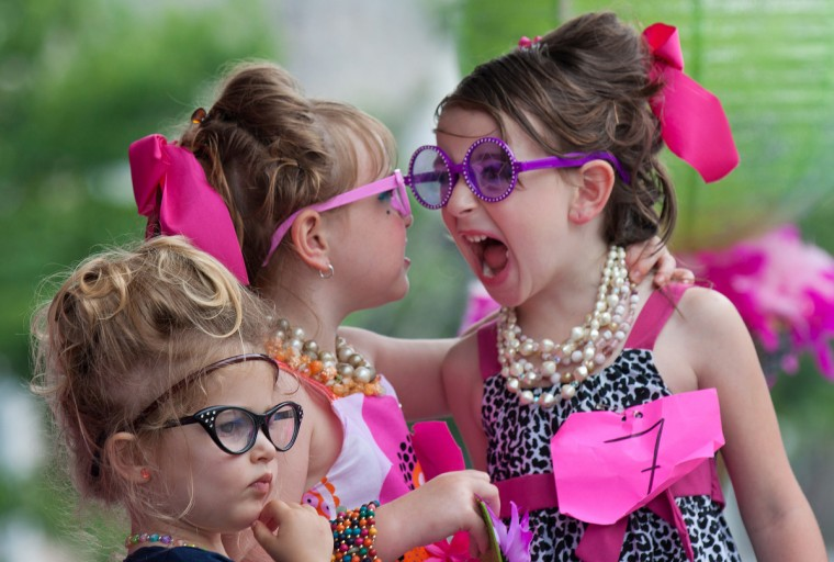 "Kevin Moore is this week's SunShots winner for the series ""Festivals."" This picture was from last year's Honfest with a Canon 50D. The girls were reacting to the winners being announced at the Lil' Miss Hon competition. Here is a critique by Baltimore Sun director of photography Robert K. Hamilton. ""Two staples of good photography are action and reaction pictures. In this image the photographer manage to capture both as this cute little girl actively reacts to the announcement of the winner of the contest."""