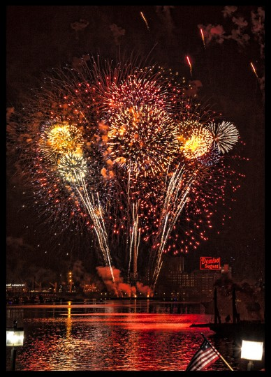 "The winner of this week's Baltimore Sun Reader SunShots series ""Fireworks"" is Deborah Felmey for her picture from the Inner Harbor shot with a Canon 5D Mark II while onboard the USS Constellation. The following is a critique by The Baltimore Sun's director of photography Robert Hamilton. ""The photographer certainly had an advantageous spot to shoot from and she made the most of it. By using a prolonged shutter speed combined with the proper aperture, she was able to get numerous burst of fireworks while maintaining detail in the harbor, such as the Domino Sugar sign."""