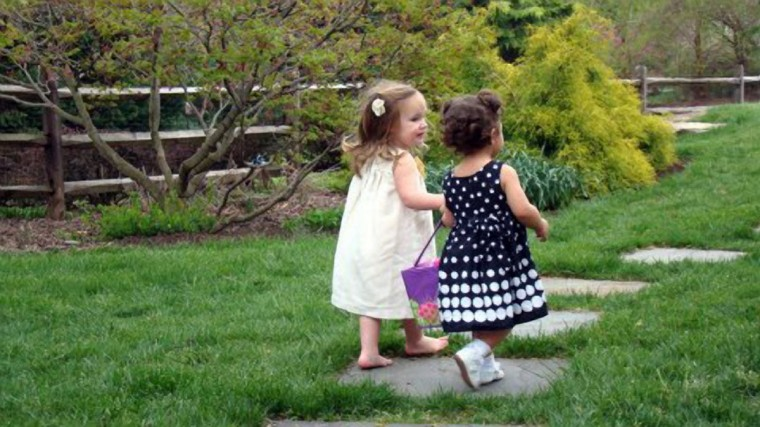 "The winner for this week's Reader SunShots series ""Happiness is..."" goes to Pat Schwartz for a picture shot of her grand daughter and friend at an Easter egg hunt. The picture was taken with a Sony DCS-H9 camera. Here is a critique by Baltimore Sun director of photography Robert K. Hamilton: ""This is sweet picture that is nicely composed. I like that the photographer chose to shoot the two girls from behind as they strolled down the path. It's a more unusual angle and gives the viewer a different perspective."""