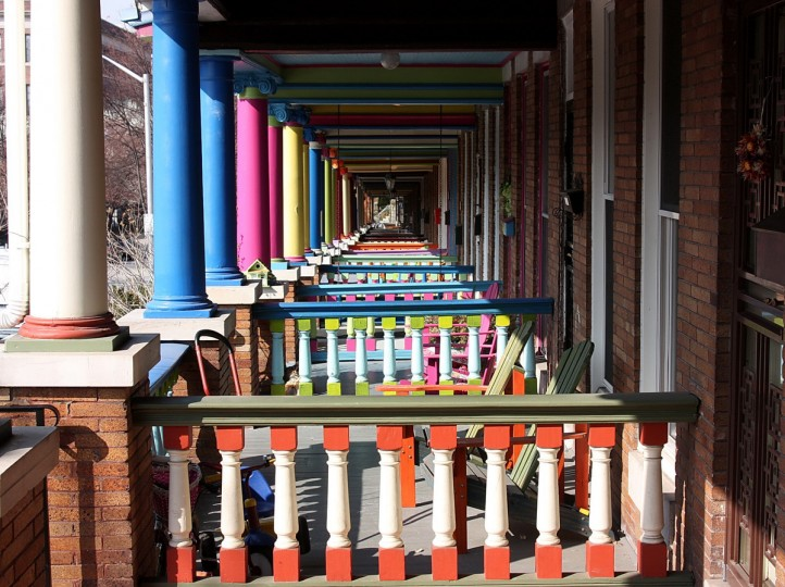 "The winner for this week's Reader SunShots series ""Pastel Colors"" goes to Ruth Schaefer for her picture of colorful porches locate in Charles Village. Ruth was fortunate to be shooting pictures when one of the rowhouse owners spotted her and invited her to get a different perspective on the often photographed homes. She took this picture with a Canon Rebel XSi. Here is a critique by Baltimore Sun director of photography Robert K. Hamilton: ""With this composition the photographer was able to capture a sense of infinity with the repeating pattern of the porches. The pictures is not only intriguing to look at but is colorful as well."""