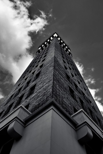 "The winner for this week's Reader SunShots series ""Street Scenes"" goes to James Gordon for his black and white photograph of the Bromo Seltzer Tower in downtown Baltimore which he took with a Canon 350D and a wide angle zoom lens. Here is a critique by Baltimore Sun director of photography Robert K. Hamilton: One way to add additional punch to your photography is to give the viewer an interesting and different perspective. The photographer, a promising photography student at Parkville High School, did just that with this image. By choosing to shoot from the corner of the building at a low angle, he gave the picture a powerful and dramatic feel and brought the clouds into play adding an additional element."""