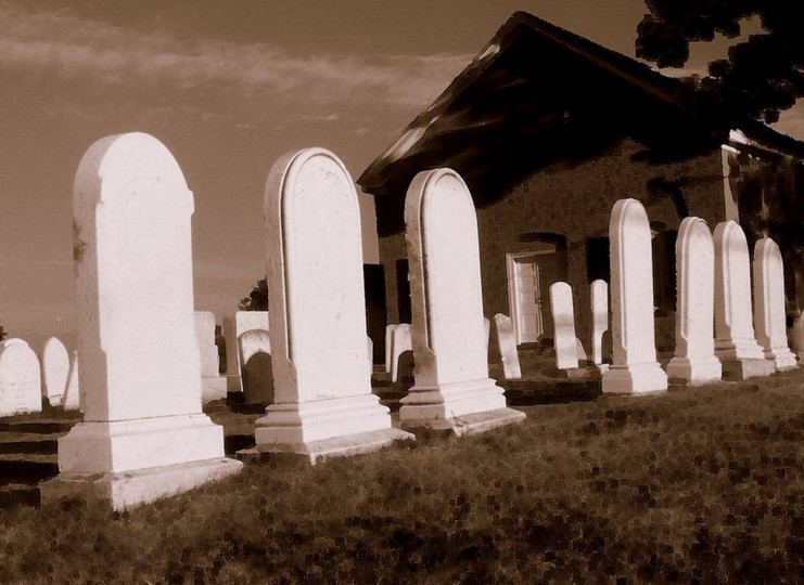 "The winner for this week's Reader SunShots series ""Tombstones"" goes to Bill Schwartz for a picture shot off Baldwin Mill Road, Maryland Route 126. The photographer shot the picture with a Nikon FM2 film camera. Here is a critique by Baltimore Sun director of photography Robert K. Hamilton: ""This is old school work going on here. The photographer shot this on black and white film with a red filter to produce a infrared effect, rich tones with bright whites and deep shadows. The image was then given a sepia effect. The end result is a striking photograph with interesting composition."""