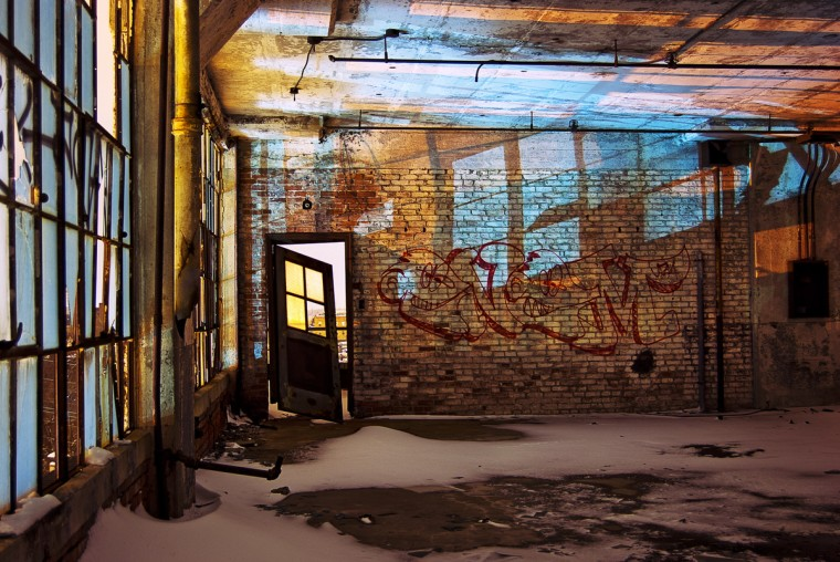 "The winner for this week's Reader SunShots series ""Windows and Doors"" goes to Glenn Lettermann for his picture shot in an abandon factory. Glenn took this picture with a Nikon D80.. Here is a critique by Baltimore Sun director of photography Robert K. Hamilton: ""We had a tremendous response in the category with lots of creative images. This pictures grab me due to it's strong graphics and the interesting light. The photographer composed the image in such a way as to take advantage of all the erie aspects of this photograph."""