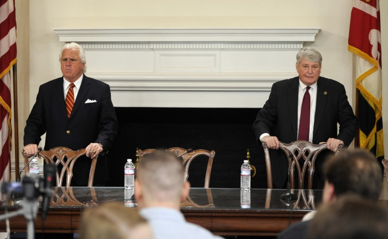 "Senate President Thomas V. Mike Miller, left, and Speaker of the House Michael Busch, right, clutch the backs of their chairs as they wait for Governor Martin O'Malley to arrive at a bill signing ceremony this morning. The leaders needed a special session to avoid ""doomsday"" budget cuts. (Barbara Haddock Taylor/Baltimore Sun)"