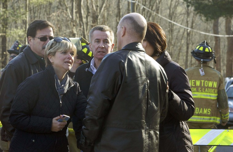 Parents talk to a man outside Sandy Hook Elementary School after a shooting in Newtown, Connecticut. At least 27 people, including children, were killed on Friday when at least one shooter opened fire at the elementary school in Newtown, Connecticut, CBS News reported, citing unnamed officials. (Michelle McLoughlin/Reuters photo)