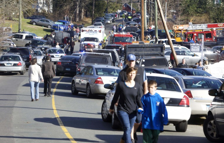 Parents pick-up their children near Sandy Hook Elementary School in Newtown, Connecticut. A shooter opened fire at the elementary school in Newtown, Connecticut, on Friday, killing several people including children, the Hartford Courant newspaper reported. (Michelle McLoughlin/Reuters photo)