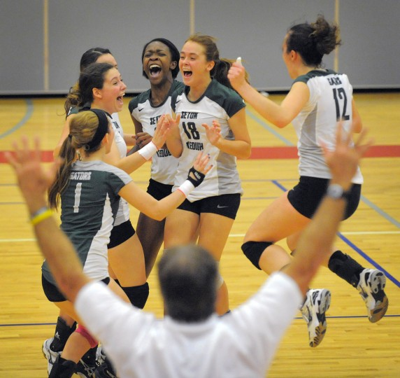 Seton Keough Gators teammates (clockwise from left) Jeni Ford (1), Meg Wickless, Brooke Stiner, Ijeoma Igwe, Hailee Clampitt (18) and Rachel Robinson (12) celebrate sealing the win and the championship over the Archbishop Spalding Cavaliers in Game 4 of the A Conference IAAM Volleyball Championship. (Karl Merton Ferron/Baltimore Sun)