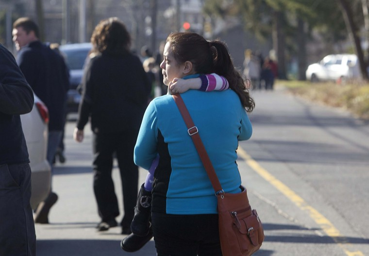 A woman carries her daughter following a shooting at Sandy Hook Elementary School in Newtown, Connecticut. A shooter opened fire at the elementary school in Newtown, Connecticut, on Friday, killing several people including children, the Hartford Courant newspaper reported. (Michelle McLoughlin/Reuters photo)