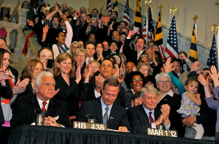 Maryland Governor Martin O'Malley signs the same-sex marriage bill at the Statehouse. The bill would eventually be put to the voters in November where it passed. (Amy Davis/Baltimore Sun)