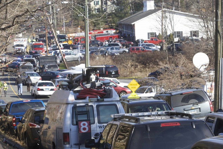 The scene at Sandy Hook Elementary School in Newtown, Connecticut. A shooter opened fire at the elementary school in Newtown, Connecticut, on Friday, killing several people including children, the Hartford Courant newspaper reported. (Michelle McLoughlin/Reuters photo)