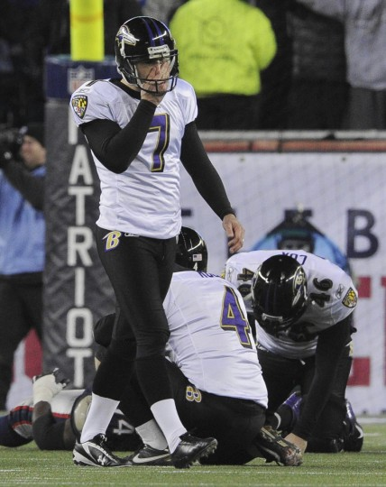 Ravens kicker Billy Cundiff walks off the field after missing the game tying field goal in the AFC Championship game, while #4 Sam Koch and #46 Morgan Cox slump in dejection. (Gene Sweeney Jr/Baltimore Sun)