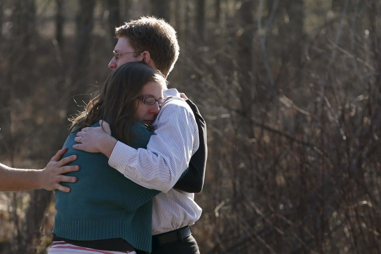 Family members embrace each other outside Sandy Hook Elementary School after a shooting in Newtown, Connecticut. (Adrees Latif/Reuters photo)