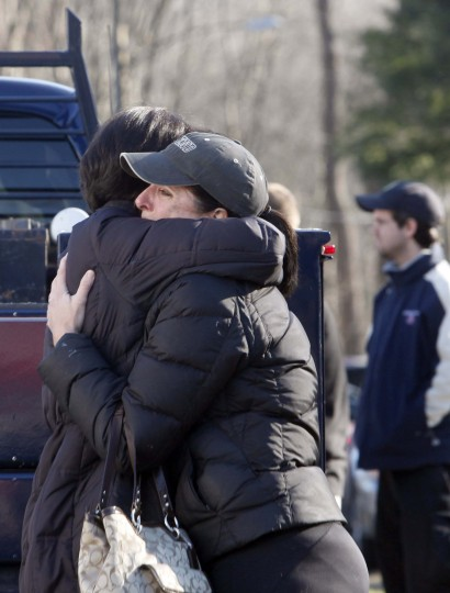 Relatives embrace each other outside Sandy Hook Elementary School following a shooting in Newtown, Connecticut. At least 27 people, including 18 children, were killed on Friday when at least one shooter opened fire at an elementary school in Newtown, Connecticut, CBS News reported, citing unnamed officials. (Michelle McLoughlin/Reuters photo)